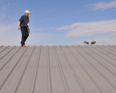 An inspector checking the roof on a commercial building.
